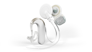 Parts of a cochlear implant from the Med-El website. From left to right- the processor with magnet and the internal device